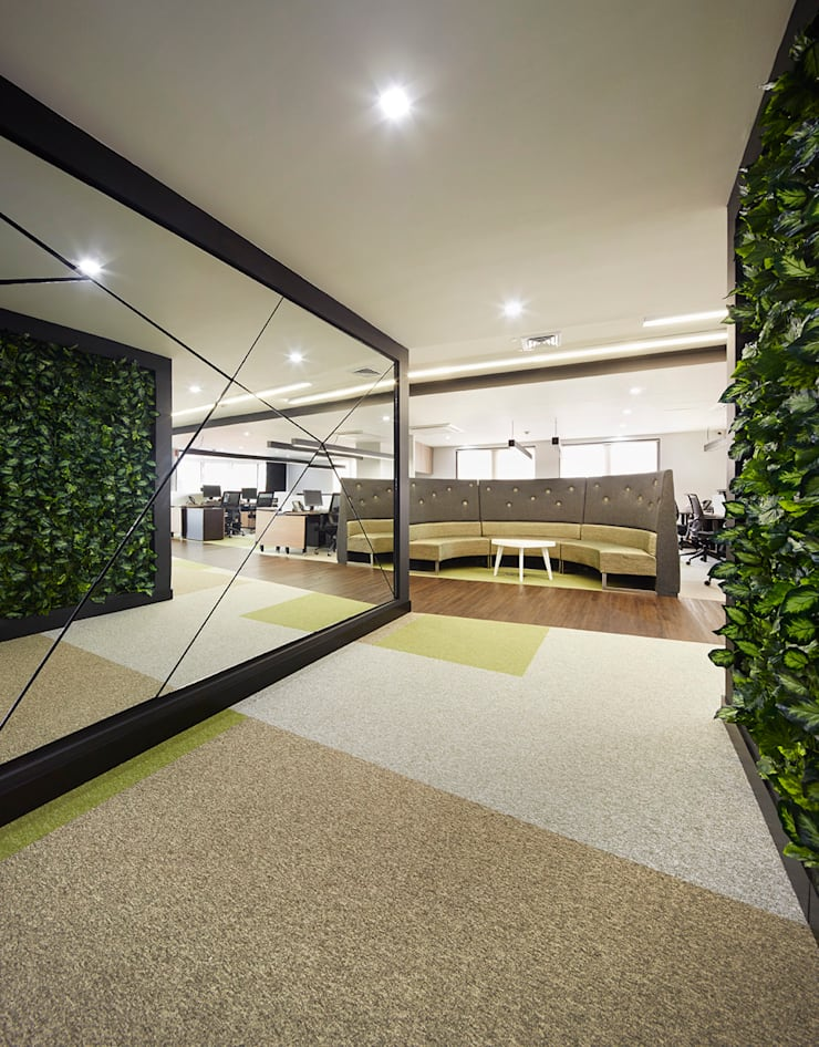 Biotoscana: Oficinas y Tiendas de estilo  por Arquint Colombia