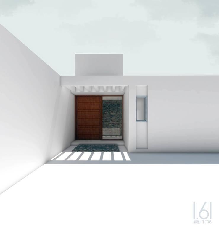 Acceso principal: Casas unifamiliares de estilo  por 1.61 Arquitectos