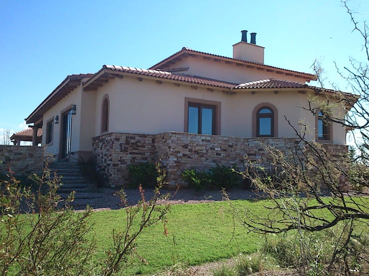 Vista este: Casas de estilo  por Azcona Vega Arquitectos,Rústico