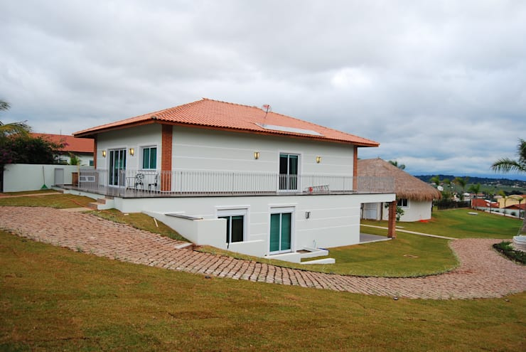 Casa de Hóspedes: Casas  por MBDesign Arquitetura & Interiores