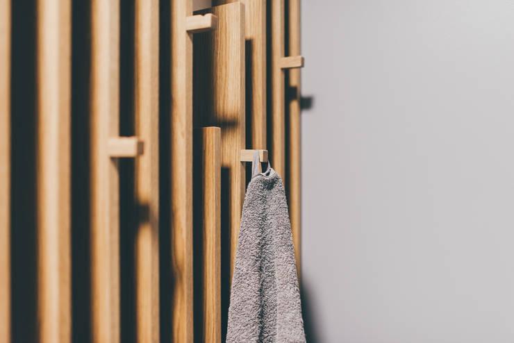 projekt aranżacji apartamentu w Gdyni: styl , w kategorii Łazienka zaprojektowany przez em2