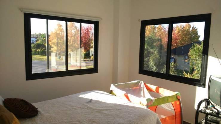 CASA CSHA: Dormitorios de estilo  por DS Arquitectos