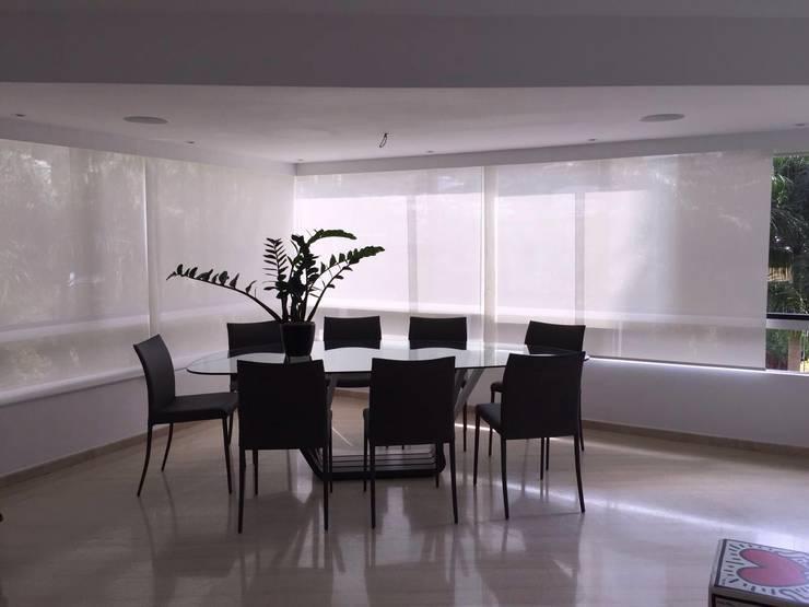 Apto. Los Chorros: Comedores de estilo moderno por THE muebles