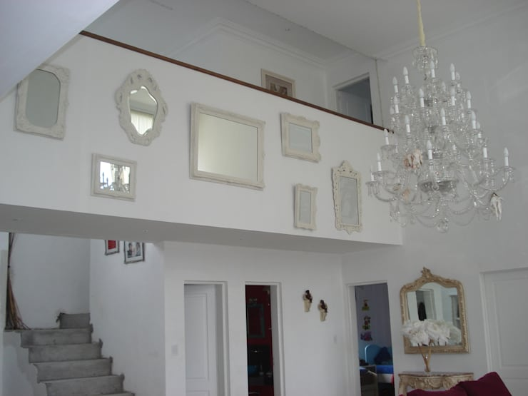 Interiores de Viviendas y Local Comercial: Hogar de estilo  por Estudio Arquitectura Integral