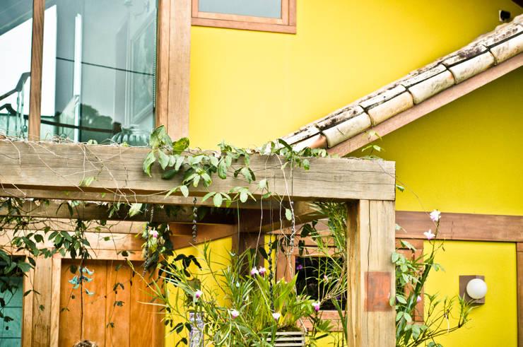 Casas de estilo  por CARLOS EDUARDO DE LACERDA ARQUITETURA E PLANEJAMENTO LTDA.