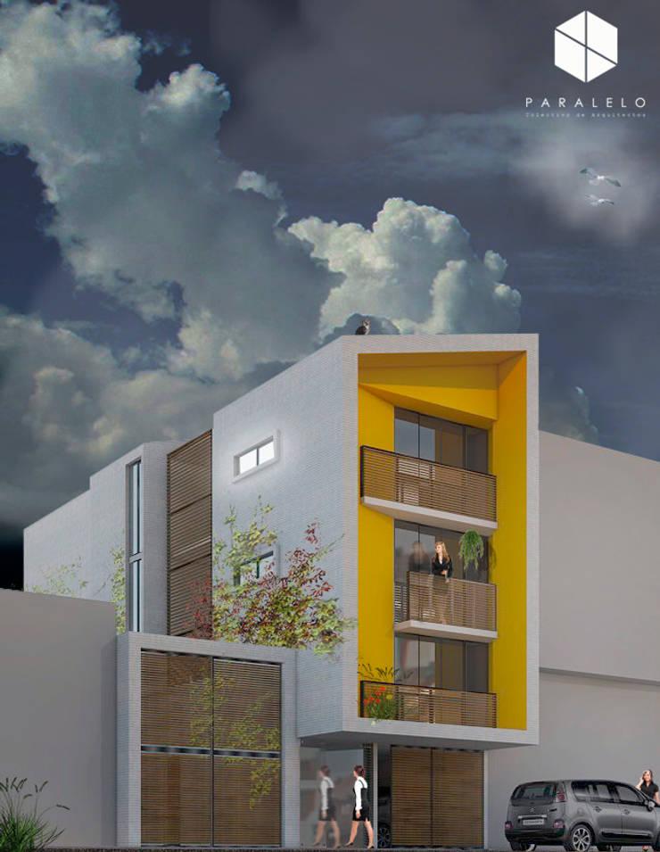 fachada noche de paralelocolectivo de arquitectos Moderno