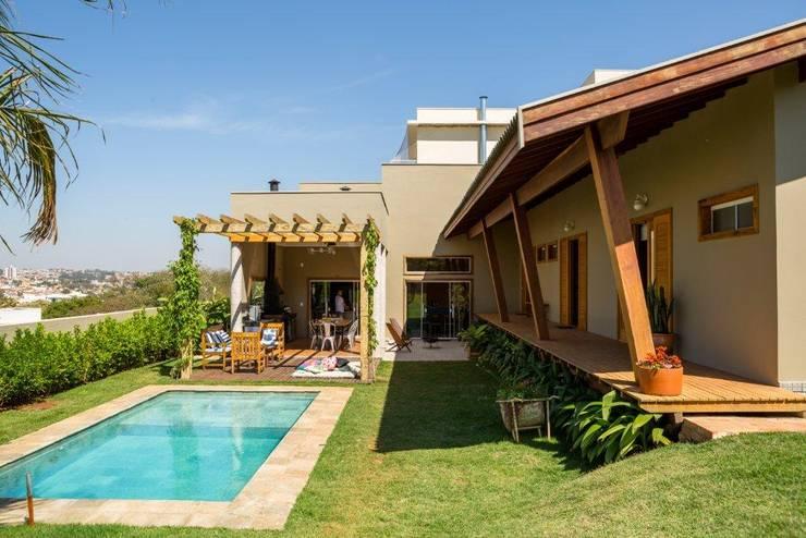 Houses by Flavio Vila Nova Arquitetura, Modern