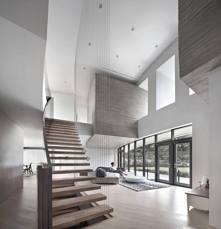 송도주택: 아키텍케이 건축사사무소의  거실
