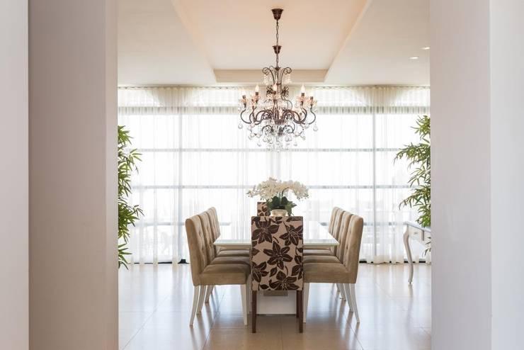 Residência L&E Foz do Iguaçu - PR: Salas de jantar ecléticas por Marcelo Lopes Arquitetura