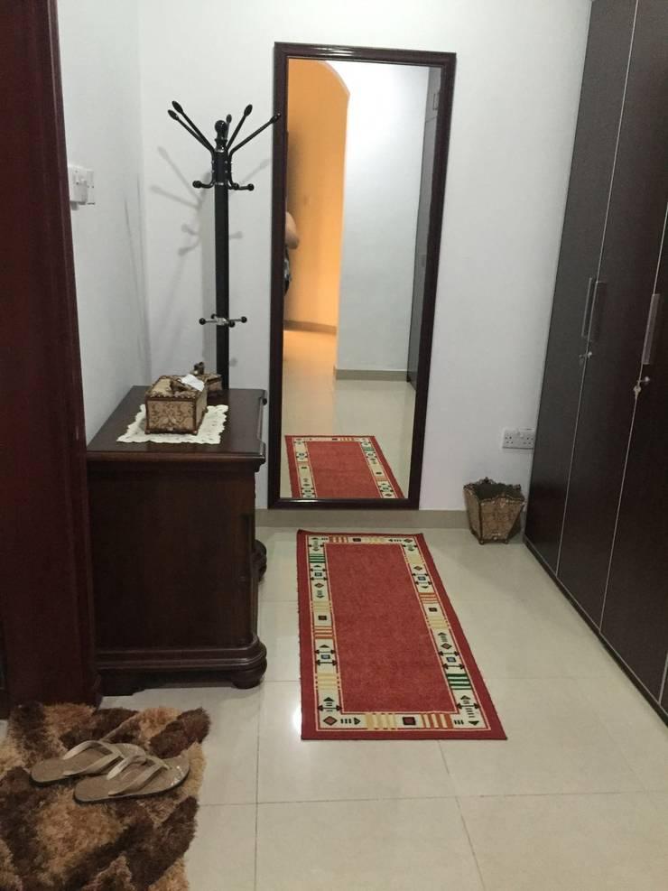Villa Interiors Muscat:  Corridor & hallway by KamalKavitaInteriors