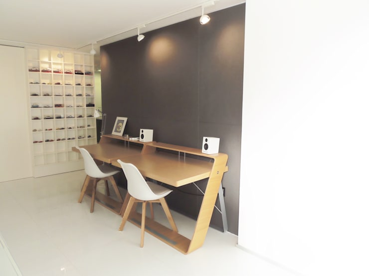 Reforma interior : Estudios y despachos de estilo  de DIsens®