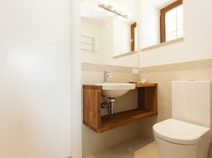Banheiros  por Bornelo Interior Design