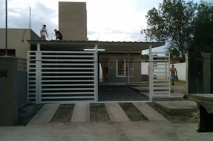 Vivienda Pro.Cre.Ar en Malagueño: Casas de estilo  por Arqs. Enríquez Ingaramo