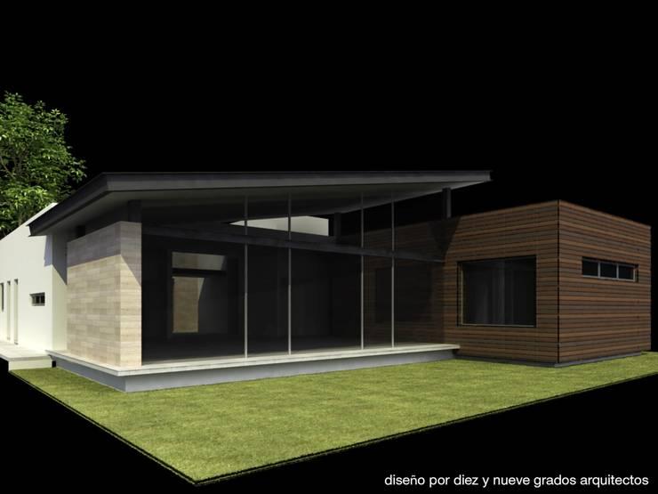Fachada posterior:  de estilo  por Diez y Nueve Grados Arquitectos