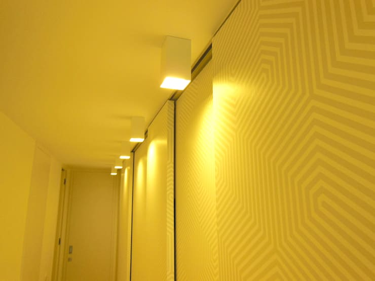 Apartamento : Corredores e halls de entrada  por Poliune