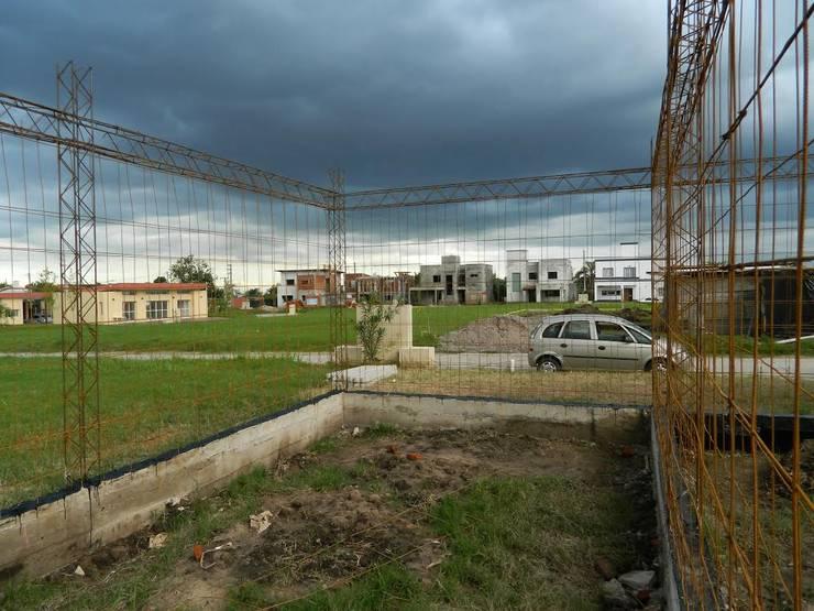 "ARQUITECTURA BIOCLIMATICA ""ECO CIMBRA"":  de estilo  por FERRER||AGUIRRE ARQUITECTURA+DISEÑO+MUEBLES,"