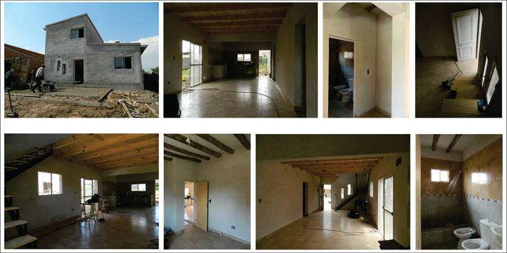 "ARQUITECTURA BIOCLIMATICA ""ECO CIMBRA"" 2: Casas de estilo  por FERRER||AGUIRRE ARQUITECTURA+DISEÑO+MUEBLES,Rural"