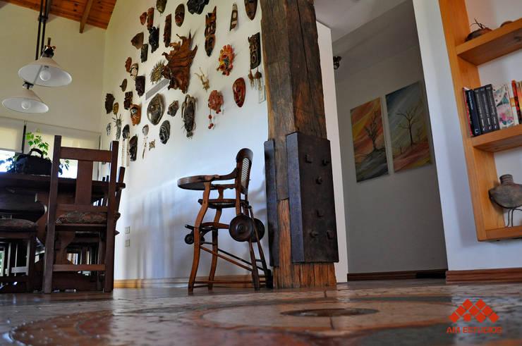 Dining room by AM Estudios