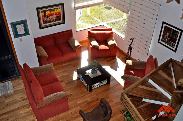 Living room by AM Estudios