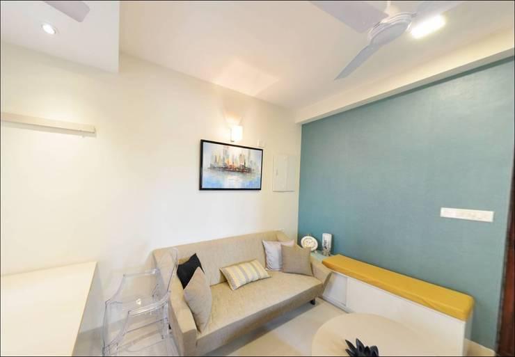 Living room:  Living room by Uncut Design Lab