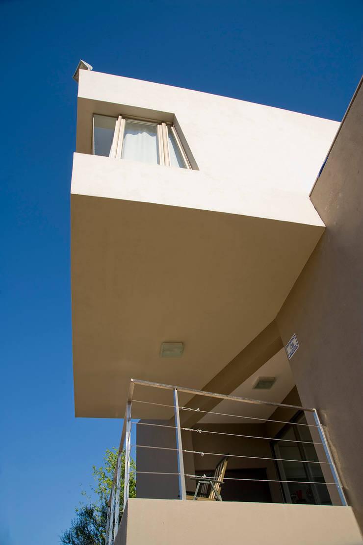 Detalle Exterior: Casas de estilo  por Poggi Schmit Arquitectura,Moderno
