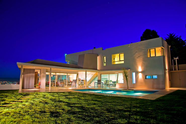 Casas de estilo  por Poggi Schmit Arquitectura