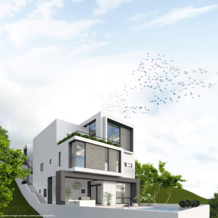 Perspectiva posterior:  de estilo  por Diez y Nueve Grados Arquitectos