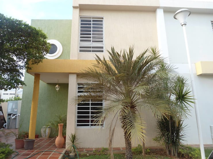 Casas de estilo  por Clinica De Casas