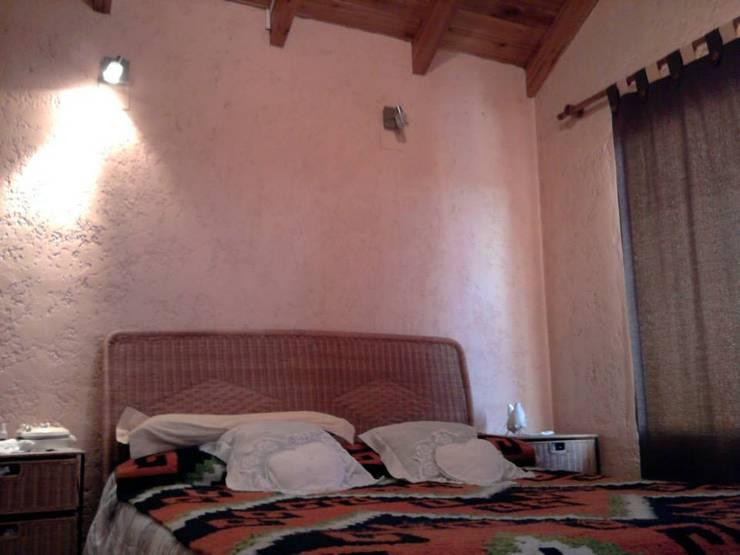 complejo de cabañas: Dormitorios de estilo  por KUN&Aso,