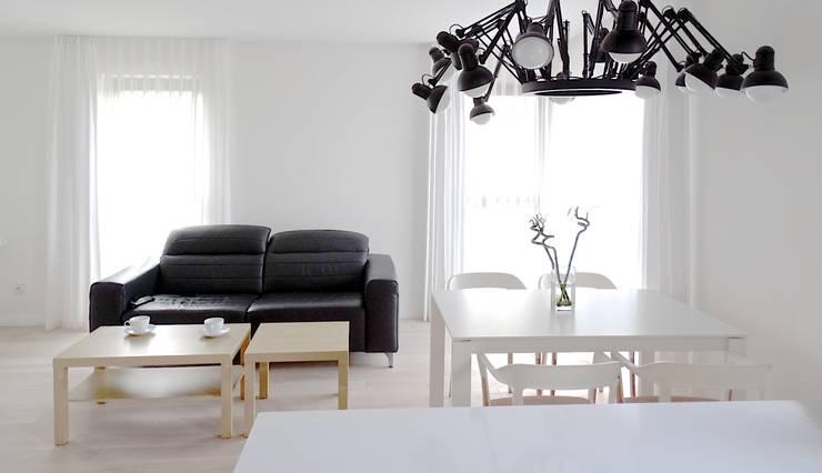 Salas de jantar minimalistas por MINIMOO Architektura Wnętrz
