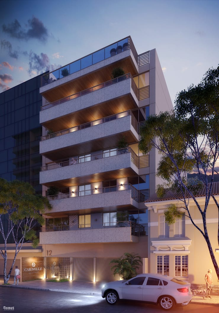EDIFÍCIO CARAVELLE | Fachada Noturna: Casas  por Tato Bittencourt Arquitetos Associados