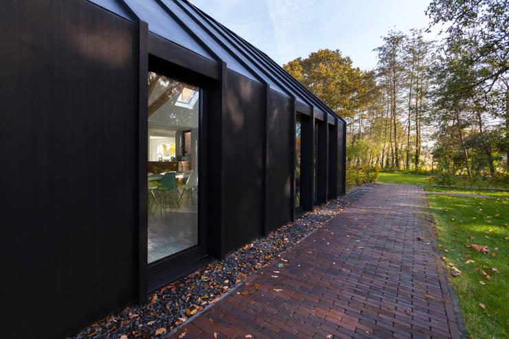 Salas / recibidores de estilo  por Bureau Fraai, Moderno