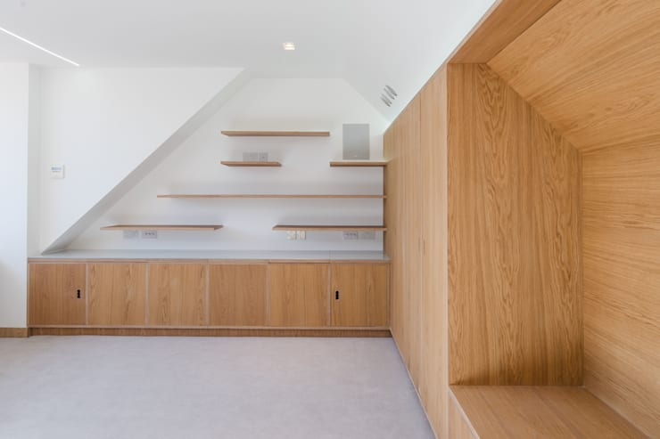 Finchley loft conversion:  Bedroom by Satish Jassal Architects
