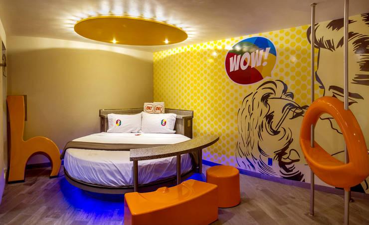 Hotel Oriente OH!: Recámaras de estilo  por DIN Interiorismo