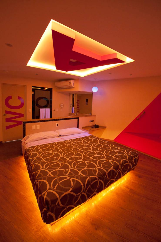 Hotel ABCentral : Recámaras de estilo  por DIN Interiorismo