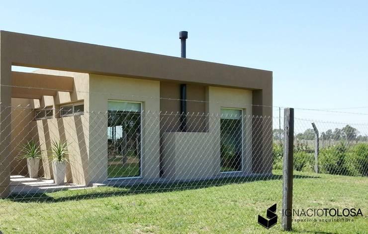 Vivienda Unifamiliar: Casas de estilo  por Ignacio Tolosa Arquitectura,
