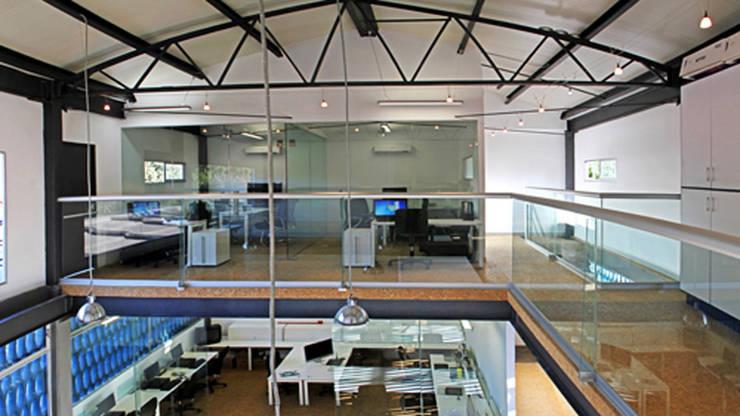 Canal 22: Estudios y oficinas de estilo  por DIN Interiorismo