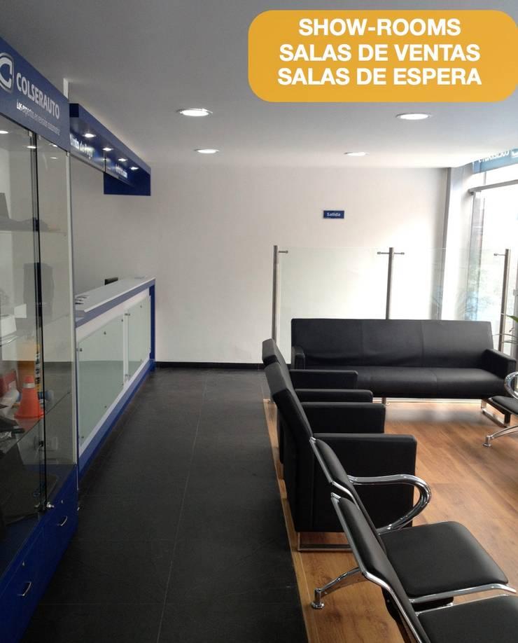 Arquitectura y desarrollo de oficinas Bogota: Oficinas y tiendas de estilo  por  Arquitectura Modular Residencial Comercial Interiorismo,