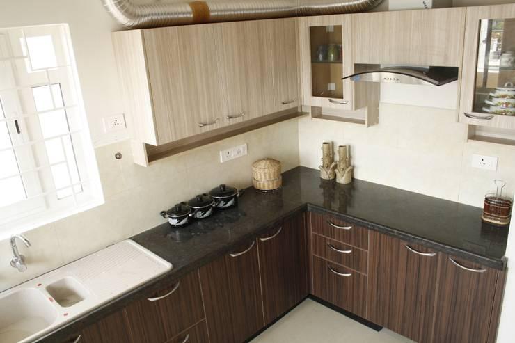 Kitchen 3: asian Kitchen by Ashpra interiors