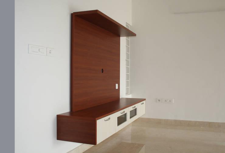 Living TV: asian Living room by Ashpra interiors