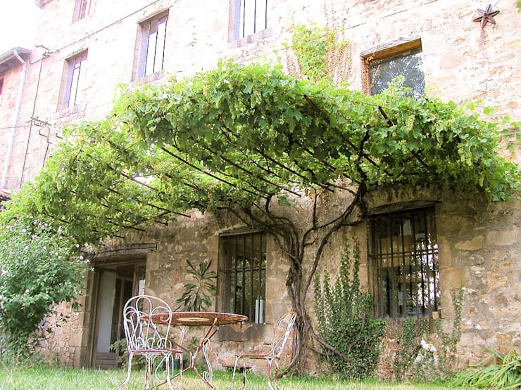 Jardines de estilo  por FRANCIS BENINCA