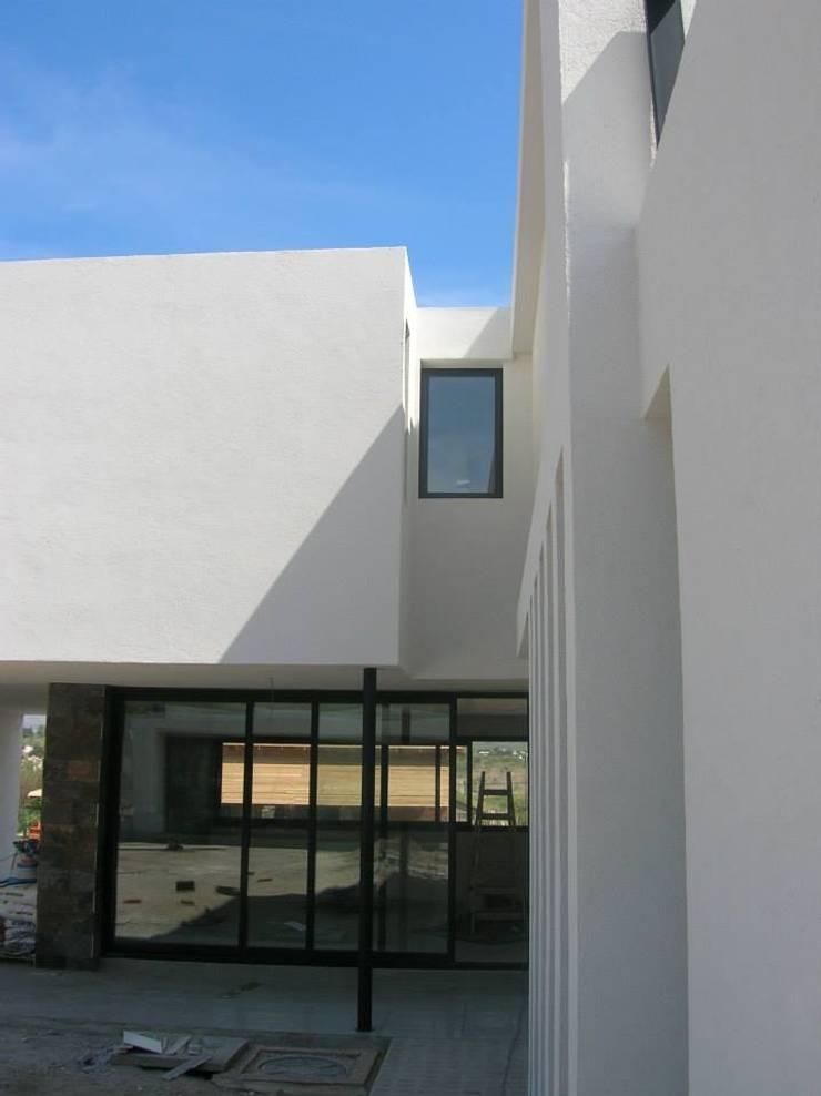 Maisons de style  par Estudio Arquitectura Agustín Duarte