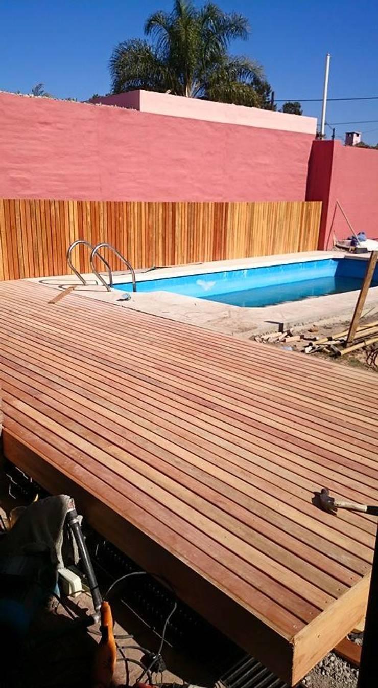 Casa Jardín: Piletas de estilo  por Lucas Rubio Arquitecto,
