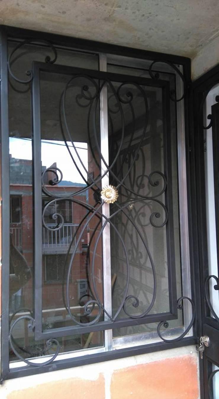 Trabajos realizados: Puertas y ventanas de estilo clásico por la tienda del cerrajero