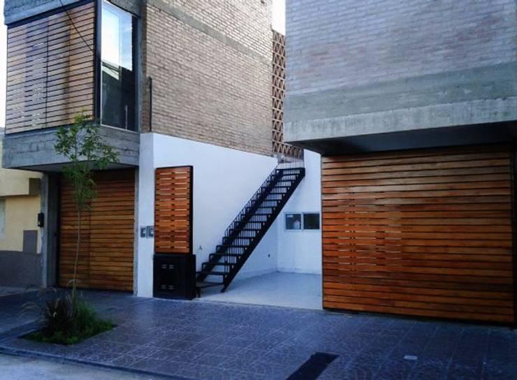 Casa Patios – Santiago del Estero (2014): Casas de estilo  por estudio 1/4,