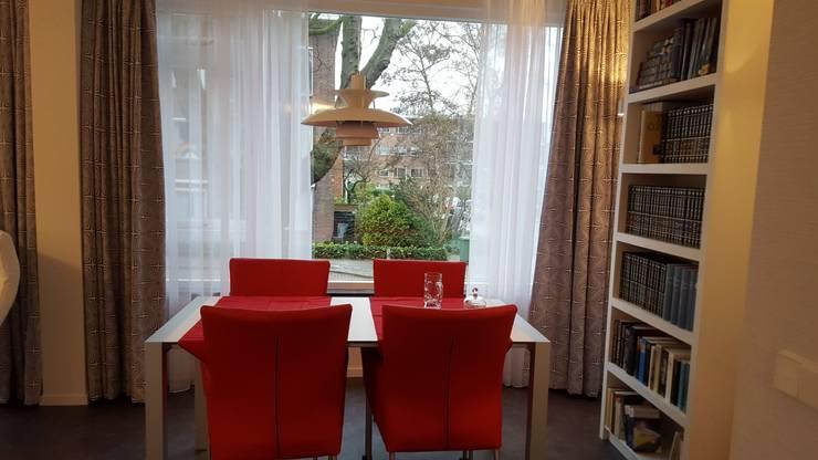 Eet en werktafel:  Woonkamer door Interieurarchitect Selma van der Velden-Artun, Modern