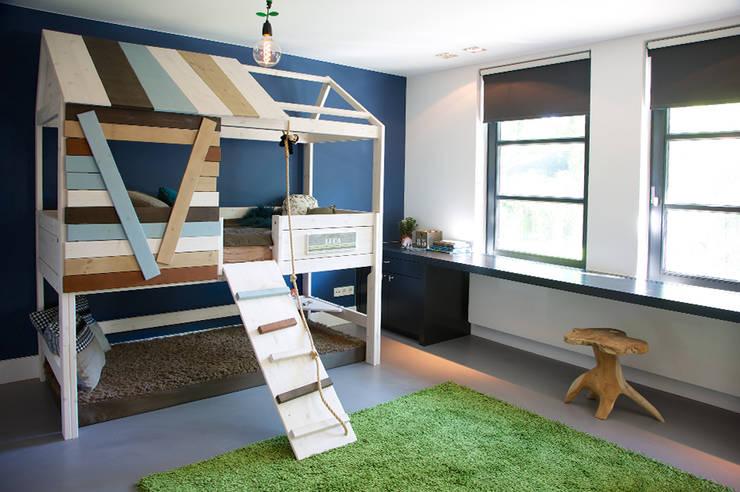 嬰兒/兒童房 by Designa Interieur & Architectuur BNA