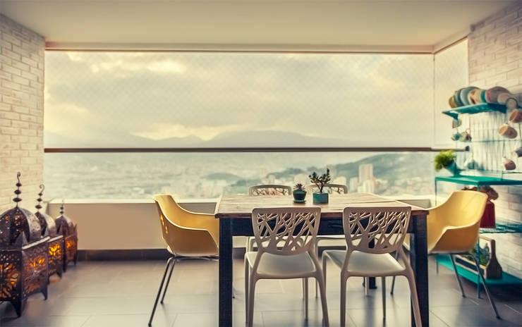 Balcón: Balcones y terrazas de estilo  por Cristina Cortés Diseño y Decoración
