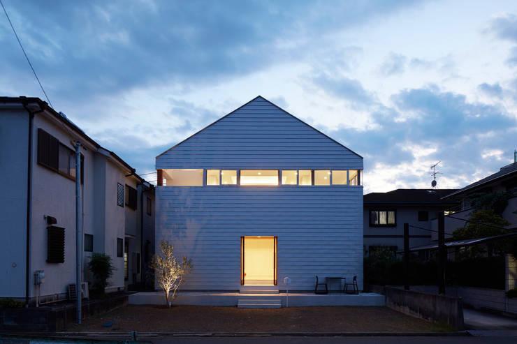 Casas de estilo  por 小泉設計室