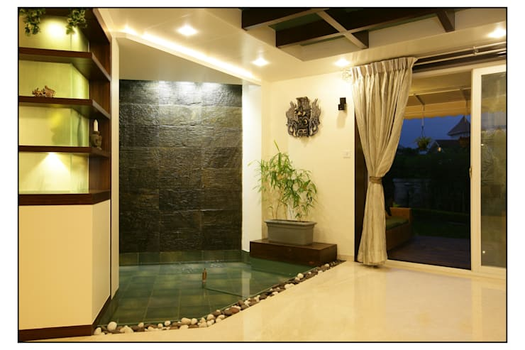 A small water curtain creates a calming effect in the home:  Pool by Navmiti Designs